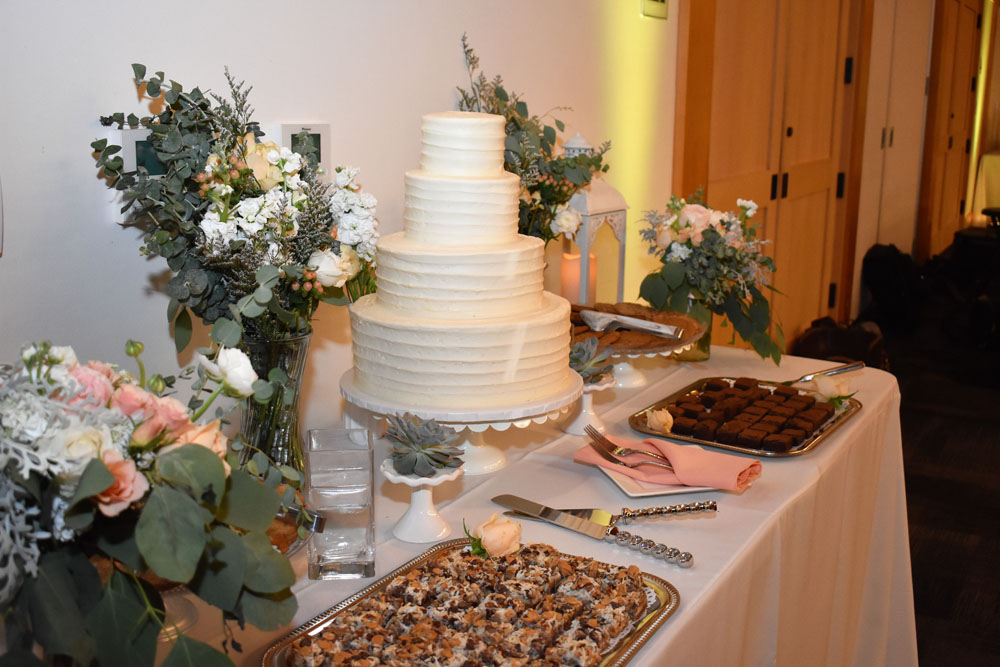 beautiful cake and dessert table was displayed taunting everyone